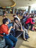 People waiting at the airport Stock Photo