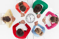 People waiting around wall clock Royalty Free Stock Photo