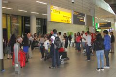 People are waiting for arriving family and friends in the arrival hall at Amsterdam Schiphol airport, Netherlands  Royalty Free Stock Photo