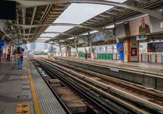 People waiting for arrival of sky train at mo chit station. Mo chit bts sky train station,Bangkok,Thailand 08 Oct 2017: People waiting for arrival of sky train stock photo