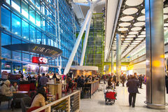 People waiting for arrivals in Heathrow airport Terminal 5, London Royalty Free Stock Photos