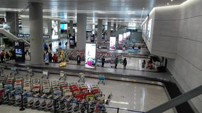 People waiting in Baggage claim area of Shanghai Hongqiao Airport Stock Photos