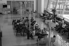 People waiting for boarding at Noi Bai airport, Hanoi, Vietnam Stock Images