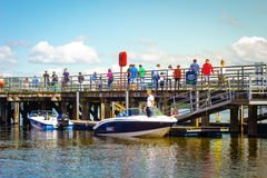 People waiting for boat trip on Summer day at Loch Lomond, Luss, Scotland Stock Image