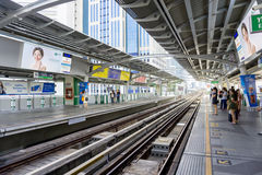 People are waiting for BTS sky train. Bangkok, Thailand - JUNE 6 : People are waiting for BTS sky train to arrive to Nana Station June 6, 2015 in Bangkok Royalty Free Stock Photos