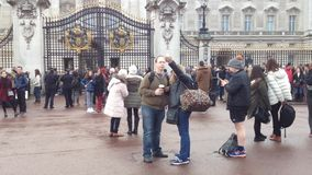 People waiting at Buckingham Palace. LONDON - DECEMBER 6:people waiting out Buckingham Palace to see the change of the guard on December 6,2015 in London -UK stock video footage