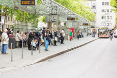 People waiting for the bus at bus stop in Friedensplatz Royalty Free Stock Image