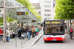 People waiting for the bus at bus stop in Friedensplatz Stock Photos