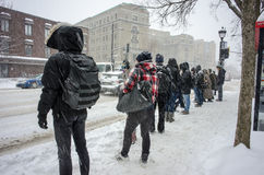 People waiting for bus on bus stop n Montreal royalty free stock image