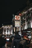 People waiting for a bus on the Oxford Circus Station bus stop on Regent Street, London, UK stock photo