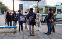 People waiting for the bus at station in Kyoto, Japan.  Stock Photography