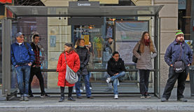 People are waiting for bus on stop station in Stock Photos