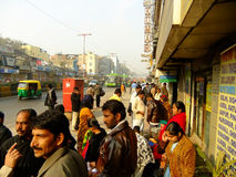 People waiting for bus on the street of Delhi Royalty Free Stock Image