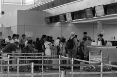 People waiting at check-in counters in Can Tho airport, Vietnam Stock Photos