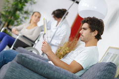 People waiting for doctor in hospital lobby Royalty Free Stock Images