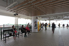 People waiting for ferry in Central pier in Hong Kong Stock Photos