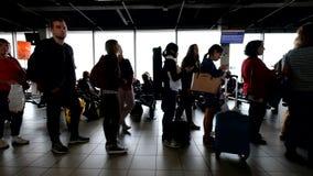 People waiting flights near departure gates stock video footage