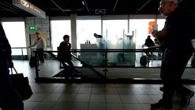 People waiting flights near departure gates stock footage