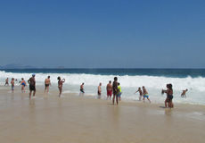 Free People Waiting For The Wave At Copacabana Beach Stock Images - 63205654