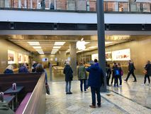 People waiting in front of Apple Store Royalty Free Stock Images