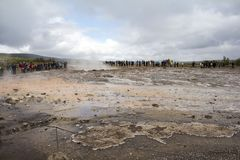 People waiting for Geysir Strokkur to erupt, Iceland. People waiting for Geysir Strokkur to erupt Iceland royalty free stock image