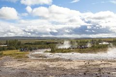 People waiting for Geysir Strokkur to erupt, Iceland. People waiting for Geysir Strokkur to erupt Iceland royalty free stock photography
