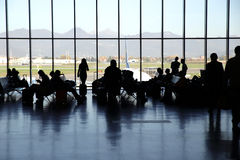 People waiting at the International Airport of Orio al Serio (Italy). People waiting behind the windows in the airport to be called Royalty Free Stock Photography
