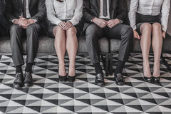 People waiting for job interview. Business people waiting for job interview sitting in a row Stock Images
