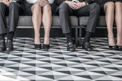 People waiting for job interview. Business people waiting for job interview sitting in a row Stock Image