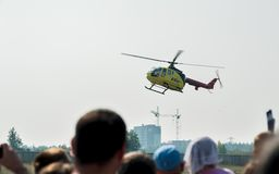 People waiting of landing Eurocopter Stock Image