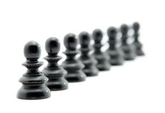 People waiting in line concept. Chess figures isolated Royalty Free Stock Images