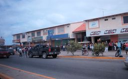 People waiting in line in the Cumana city stock image