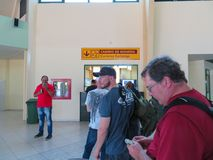 People waiting in  line at the Holguin Airport to exchange their currency royalty free stock images