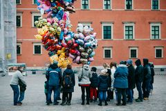 People are waiting in line to buy balloons for fun. Warsaw, December 25, 2017: People in the main city square are waiting in line to buy balloons for fun stock images
