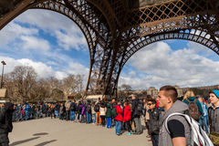 People Waiting in Long Queue at Eiffel Tower in Paris France Royalty Free Stock Photos
