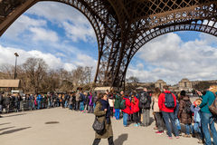 People Waiting in Long Queue at Eiffel Tower in Paris France Stock Photography