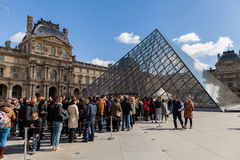 People Waiting in Long Queue at Louvre Museum in Paris France Stock Images