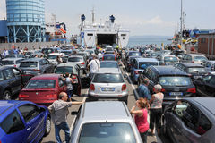 People waiting near their cars boarding the ferry Royalty Free Stock Images