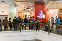 People waiting for North Face store to open. During black Friday 2014, customers were waiting eagerly outside of North Face store to take take advantage of huge Stock Photography