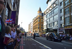 People waiting for the Olympic torch to arrive Royalty Free Stock Photo
