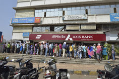 People Waiting Outside Axis Bank To Withdraw And Deposit Old Demonetizes Indian Currency In Bombay, Maharashtra ,India. Mumbai, India - November 12, 2016: People Royalty Free Stock Images
