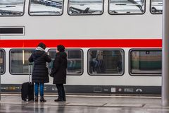 People waiting on a platform stock images