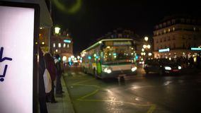 People waiting on public transport at bus stop, urban life, evening time. Stock footage stock video footage