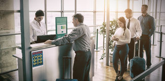 People waiting in queue at airplane counter Stock Images