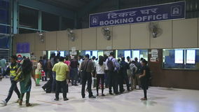 People waiting in queue at the booking office of a train station. MUMBAI, INDIA - 8 JANUARY 2015: People waiting in queue at the booking office of a train stock video