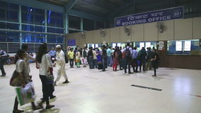 People waiting in queue at the booking office of a train station. MUMBAI, INDIA - 8 JANUARY 2015: People waiting in queue at the booking office of a train stock video footage