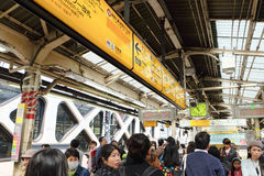 People waiting for rail train at Tokyo Stock Photo