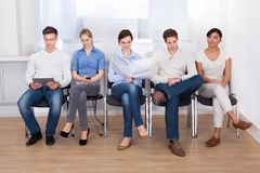 People waiting in a room Stock Photo