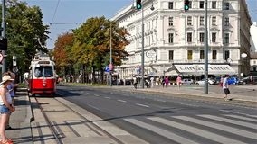 People Waiting In Station For Modern Tram In Downtown Vienna City. VIENNA, AUSTRIA - AUGUST 06, 2015: People Waiting In Station For Modern Tram In Downtown stock footage