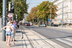 People Waiting In Station For Modern Tram Stock Photos